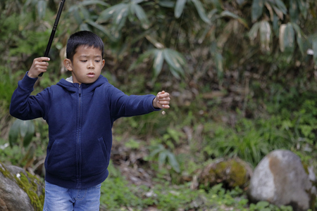Japanese boy catching fish (fourth grade at elementary school)