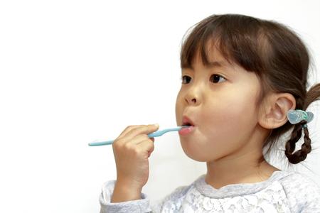 Japanese girl brushing her teeth (4 years old) Stock Photo