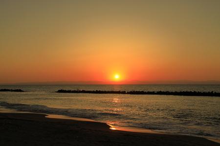 sunset at Japan sea and Sado island, view from Niigata, Japan