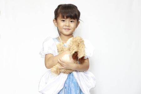 Japanese girl in a dress holding a stuffed rabbit (4 years old)