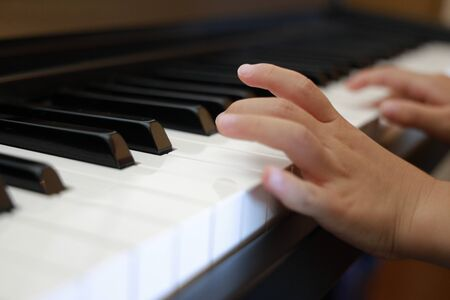 hands of Japanese girl playing a piano (4 years old)