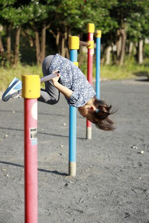 Japanese girl playing with high bar (5 years old)