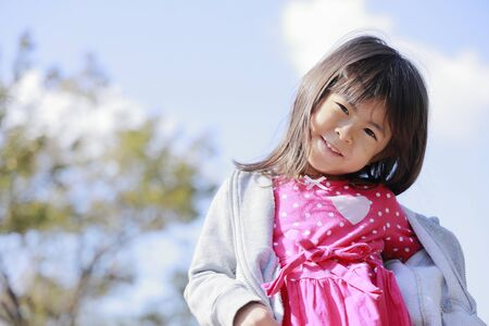 Japanese girl under the blue sky (5 years old) 写真素材