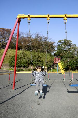 Japanese girl on the swing (5 years old)