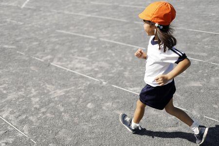running Japanese girl in sportswear (4 years old)
