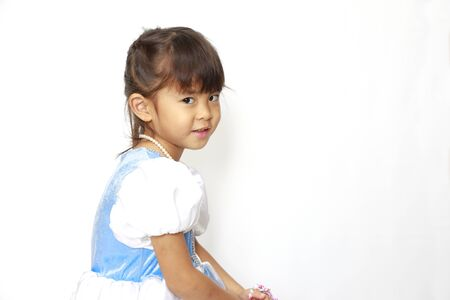 Japanese girl in a dress (profile) (4 years old) 写真素材