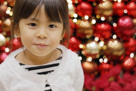 Christmas tree and Japanese girl (5 years old) 写真素材