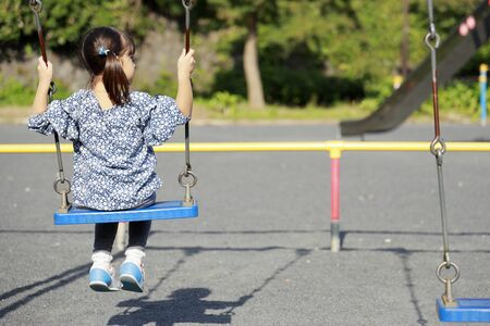 Japanese girl on the swing?(appearance from behind) (5 years old) 写真素材