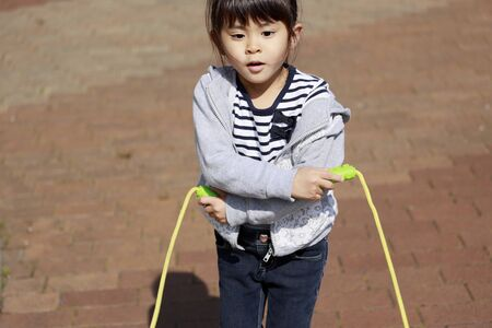 Japanese girl (5 years old) playing with jump rope