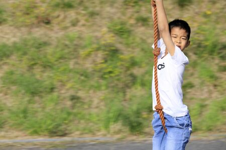 Japanese boy playing with flying fox (fourth grade at elementary school) 스톡 콘텐츠