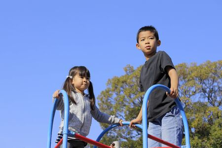Japanese brother and sister under the blue sky (10 years old boy and 5 years old girl)