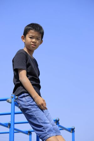 Japanese boy on the jungle gym (fifth grade at elementary school)