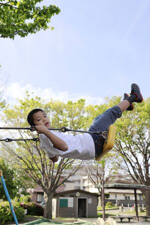 Japanese boy on the swing (fifth grade at elementary school)