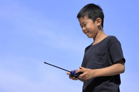 Japanese boy operationg radio control (fifth grade at elementary school)