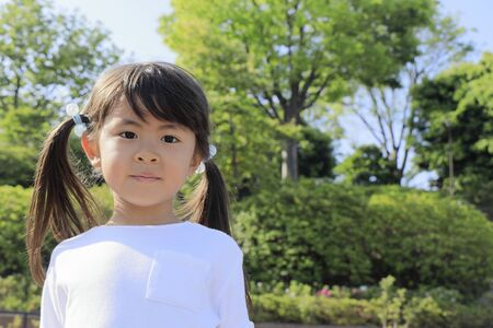 smiling Japanese girl in the green (5 years old)