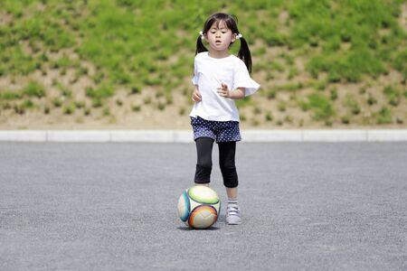 Japanese girl dribbling soccer ball (5 years old)