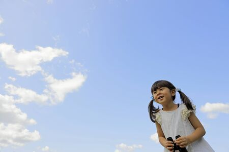 Japanese girl with opera glass under the blue sky (5 years old) Stok Fotoğraf