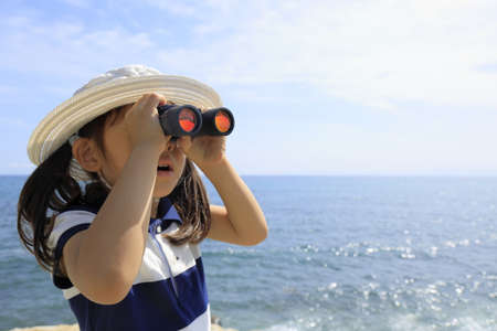 Japanese girl with opera glass at seaside (5 years old)