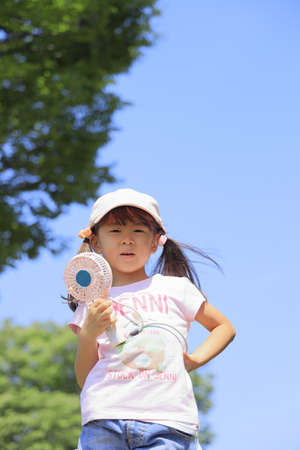 Japanese girl with portable fan (5 years old)