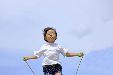 Japanese girl (5 years old) playing with jump rope Stok Fotoğraf