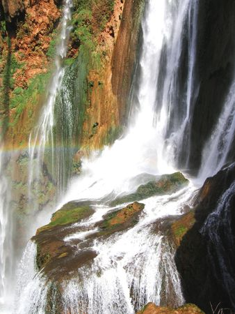 a picture of a waterfall and rainbow