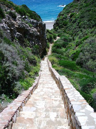 a narrow stairway to the beach