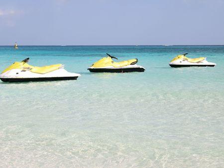 three motor boat aligned on the caribbean sea photo