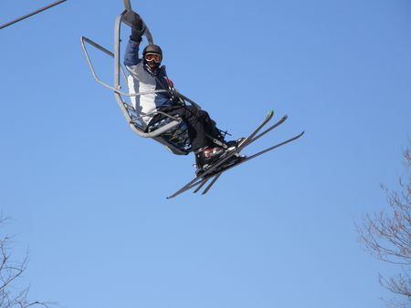 a skier in a chairlift Stock Photo - 4336265