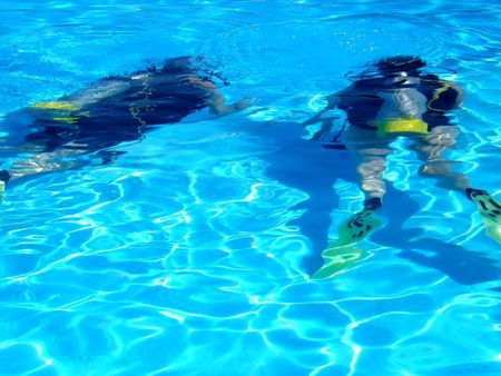 two scuba divers, practising their sport in a pool Stock Photo