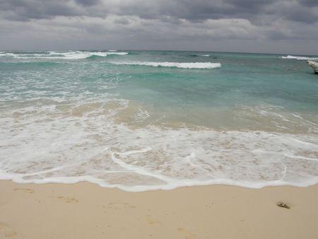 a stormy sky over the ocean shore