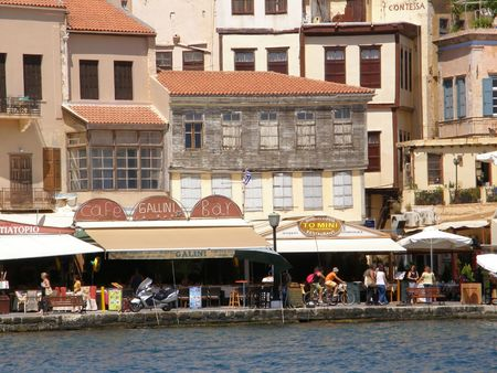 awnings: Chania little marina by the sea with shops, boutiques, restaurants and hotels Stock Photo