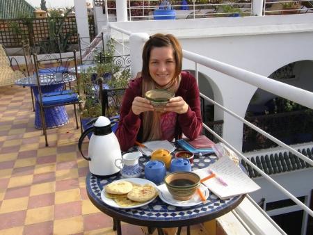 woman having breakfast on a morocan rooftop terrace