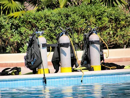 scuba diving oxygen tanks on a pool side Stock Photo