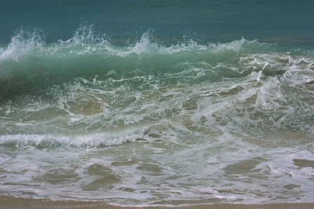 tide: choppy sea waves at high tide on beach