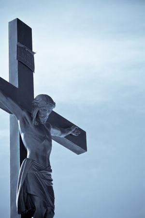 Crucifixion of Jesus Christ over blue sky background Reklamní fotografie - 6567442