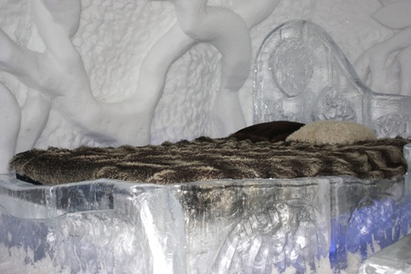 QUEBEC, CANADA- FEBRUARY 20, 2011:  One of the bedrooms in the famous ice hotel in Quebec city, Canada. Stock Photo - 8944878