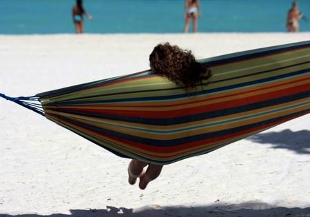 caribbeans: girl in hammock on beach Stock Photo