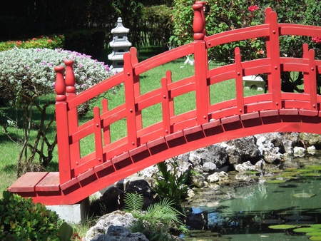 garden pond: red asian bridge in garden Stock Photo