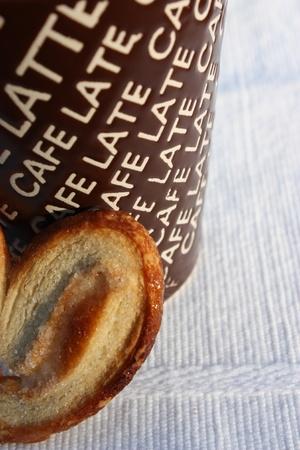 coffee mug and cookie vertical closeup