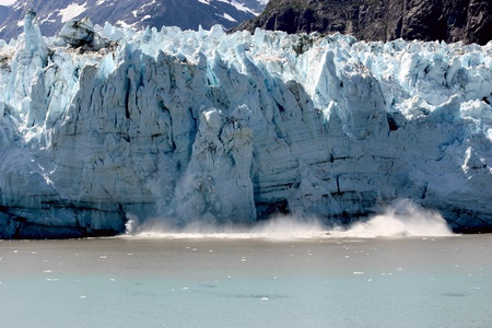 calving: Glacier calving in Glacier Bay National Park, Alaska Stock Photo