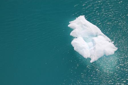 iceberg floating on ocean