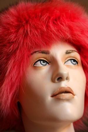 Pink fur hat on mannequin head