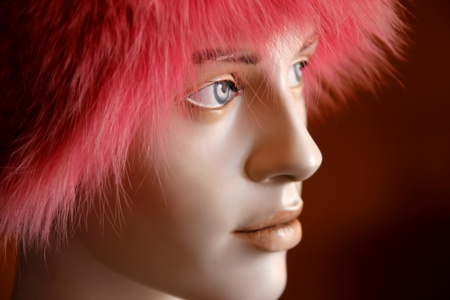 Pink fur hat on mannequin head photo