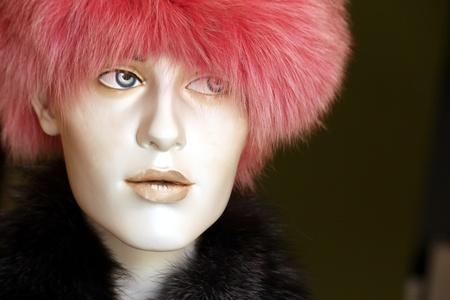 pink fur hat on mannequin photo