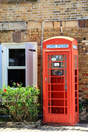 phone booth: Typical English phone booth on street corner