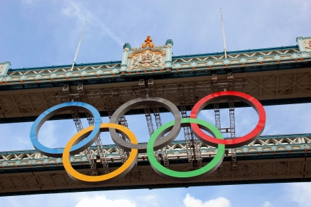 summer olympics: LONDON, ENGLAND- JULY 2012: OLympic rings suspended under the Tower Bridge. London welcomes the summer olympics.
