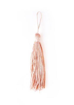 Pink silk tassel isolated on white background