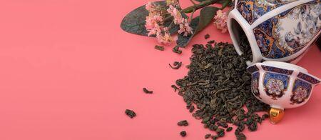 Spilled tea, porcelain Japanese vessel and flowering branch
