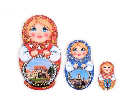 """Souvenir (magnet) from Belarus in the form of dolls isolated on white background. Belarusian inscription does the name """"Minsk"""" of the capital in English."""