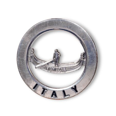 """Souvenir (magnet) from the city of Venice (Italy) isolated on white background. The inscription on the magnet means in Italian city """"Venice"""" in English."""